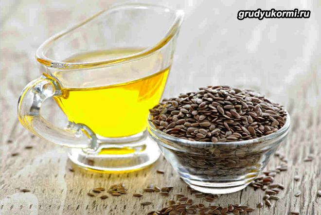 Зерна льна и льняное масло в графине
